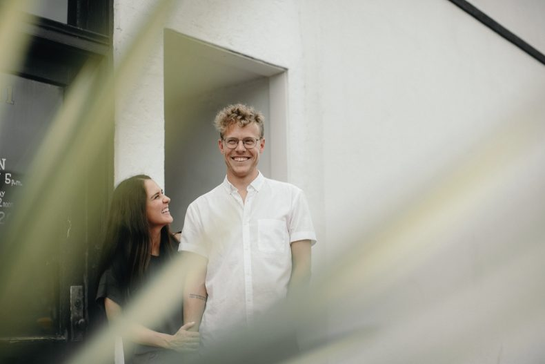 couple smiling while holding hands