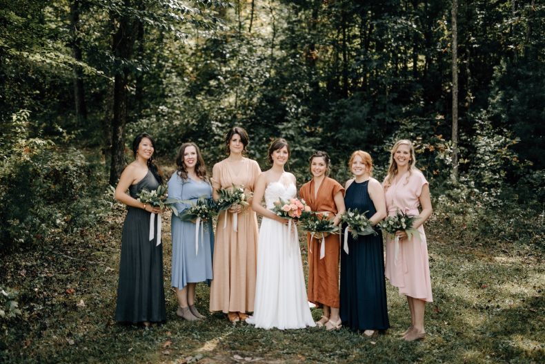 bridesmaids wearing colorful dresses at their sugarboo farms wedding in blairsville