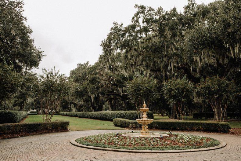 ornate gold fountain in roundabout of ford plantation