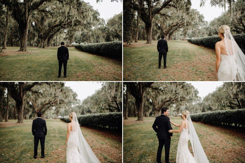 bride walking up behind groom for first look among mossy oak trees in savannah
